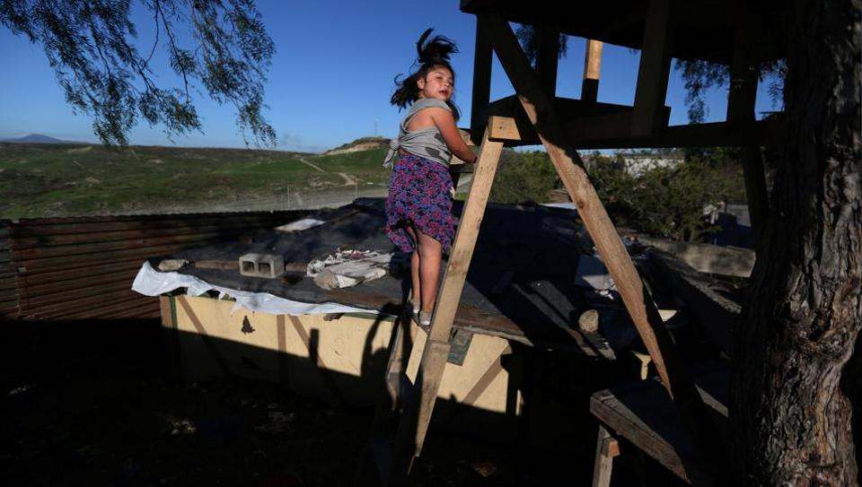 A girl climbs stairs near a section of the fence separating Mexico and the United States, in Tijuana, Mexico. The rust-red U.S. fence along the Mexican border has inspired various quirky architectural structures, from a frontier-themed mansion to a humble tree-house with uninterrupted views across the Californian scrubland. (Edgard Garrido/REUTERS)