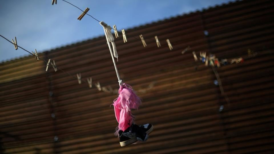 A shoe and clothes pins are seen on a clothes line next to a section of the border fence separating Mexico and the United States, on the outskirts of Tijuana, Mexico. (Edgard Garrido/REUTERS)