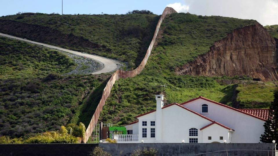 A house stands next to a section of the border fence separating Mexico and the United States. (Edgard Garrido/REUTERS)
