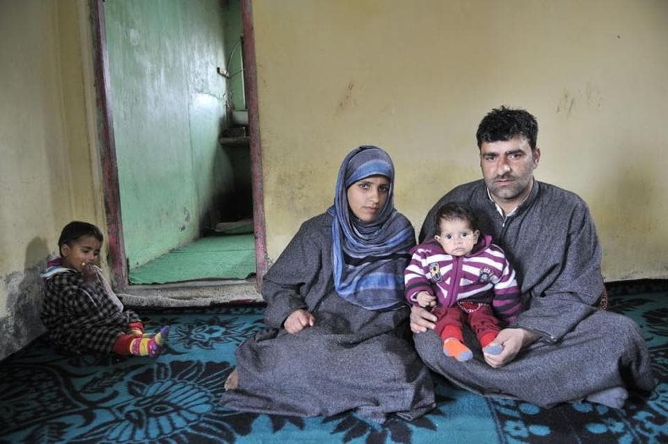 Ayat Imtiyaz with her parents at home in Kashmir. The one-year-old has a congenital heart defect that needs to be fixed surgically.