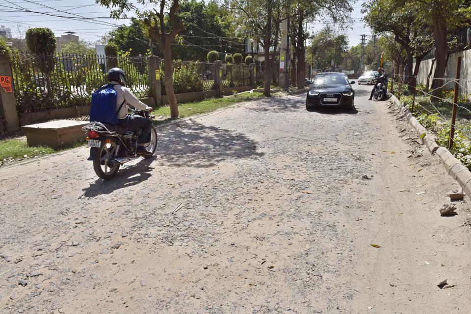 A broken road in Sushant Lok I, Gurgaon.