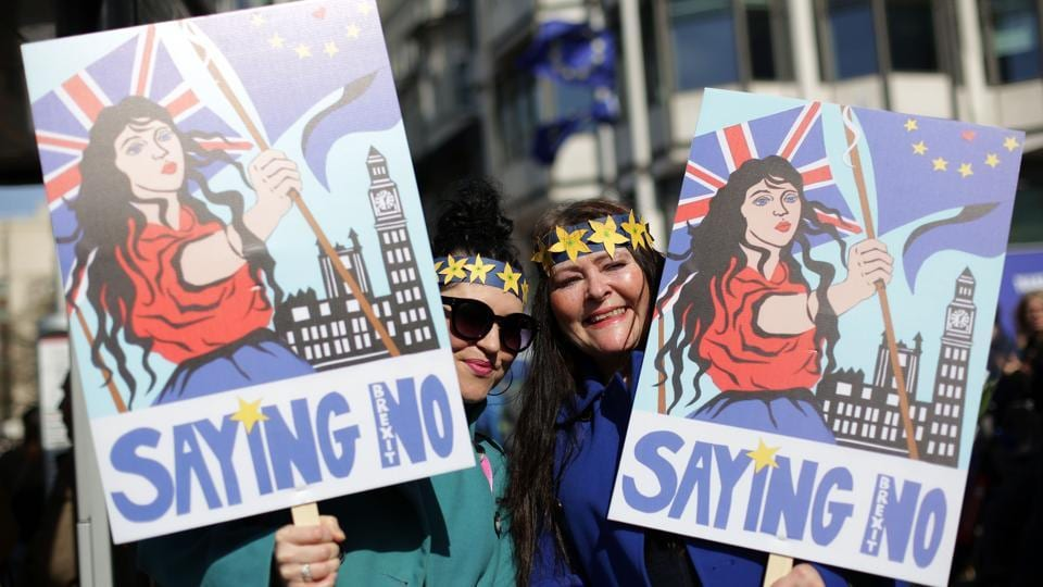 Demonstrators hold placards as they participate in an anti Brexit, pro-European Union (EU) march. Police did not provide a crowd estimate. Organizers said more than 25,000 people were present.  (AFP)
