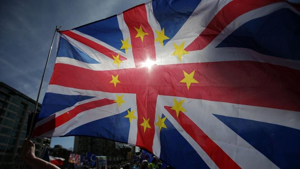 A demonstrator waves a Union flag, decorated with the stars of the EU flag, as they prepare to participate in an anti Brexit, pro-European Union (EU) march in London, ahead of the British government's planned triggering of Article 50 next week. Britain will launch the process of leaving the European Union on March 29, setting a historic and uncharted course to become the first country to withdraw from the bloc by March 2019.  (Daniel Leal-Olivas/AFP)