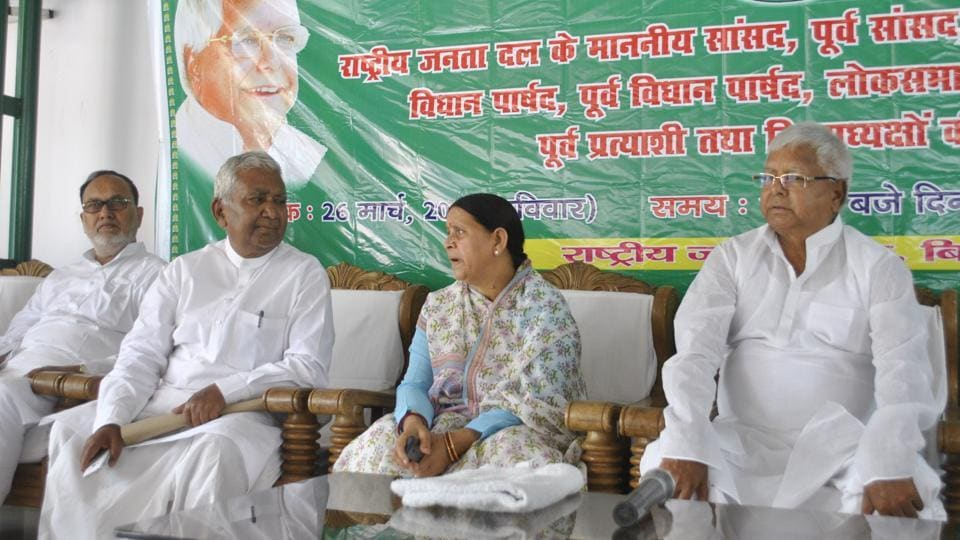 RJD chief Lalu Prasad (right) holding a meeting of party leaders, at his