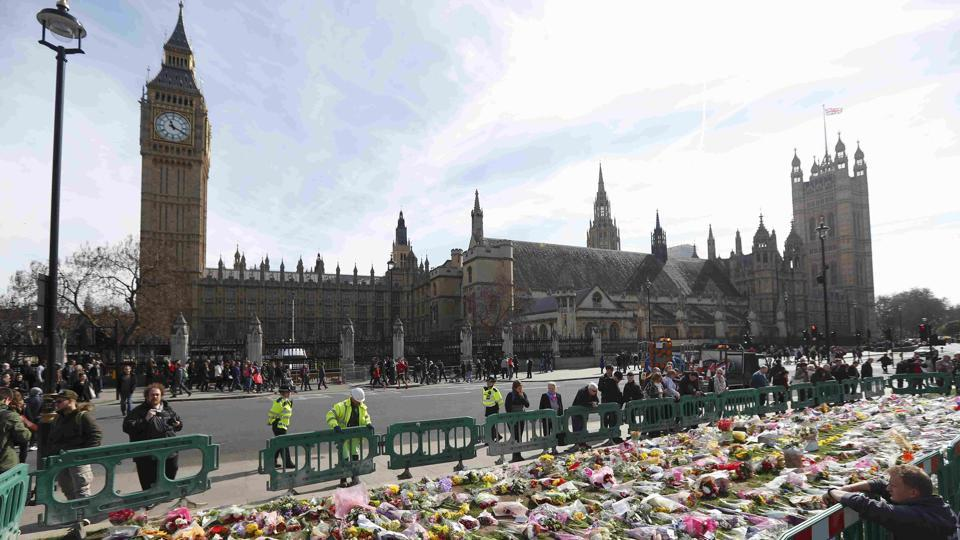 Floral tributes in Parliament Square, following the attack in Westminster earlier in the week, in London.