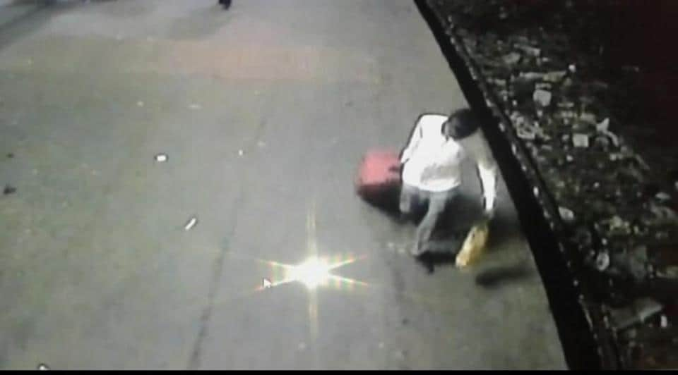 A CCTVgrab shows one of the accused carrying the trolley in which the 12-year-old was stuffed.