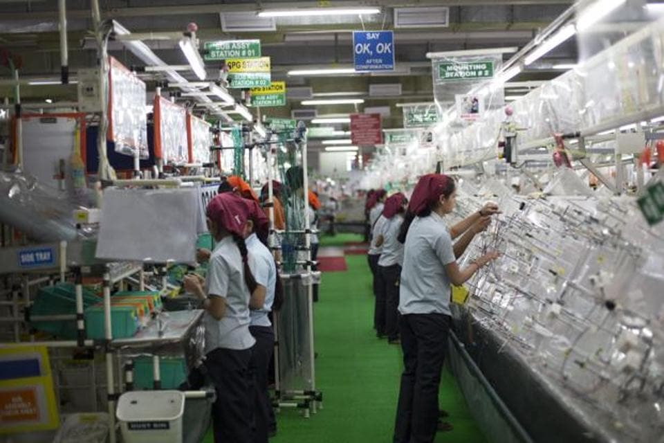 A file photo of workers assembling wire harnesses at the Motherson Sumi Systems Ltd. wiring harness plant in Faridabad.