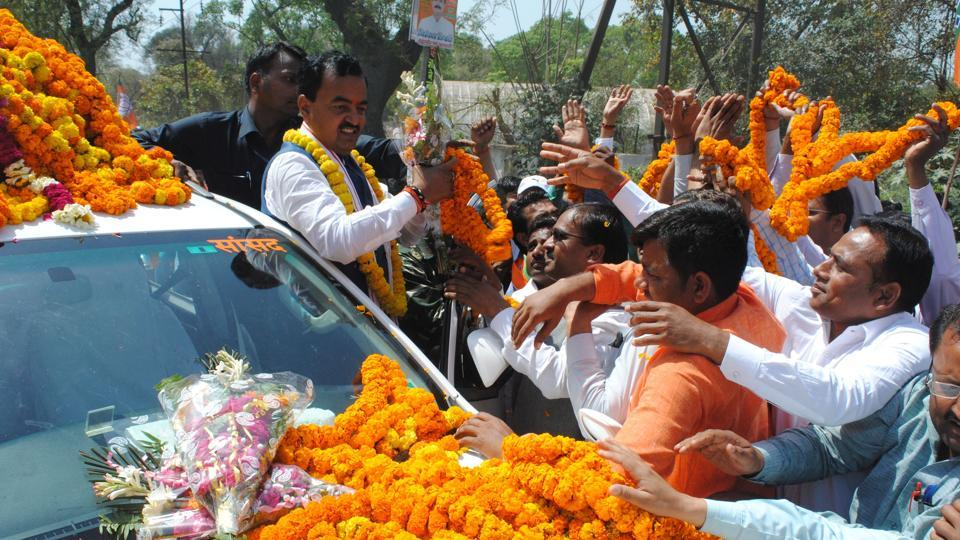 BJP leader and activists giving a warm welcome to deputy CMKeshav Prasad Maurya on his maiden visit to Allahabad on Sunday.