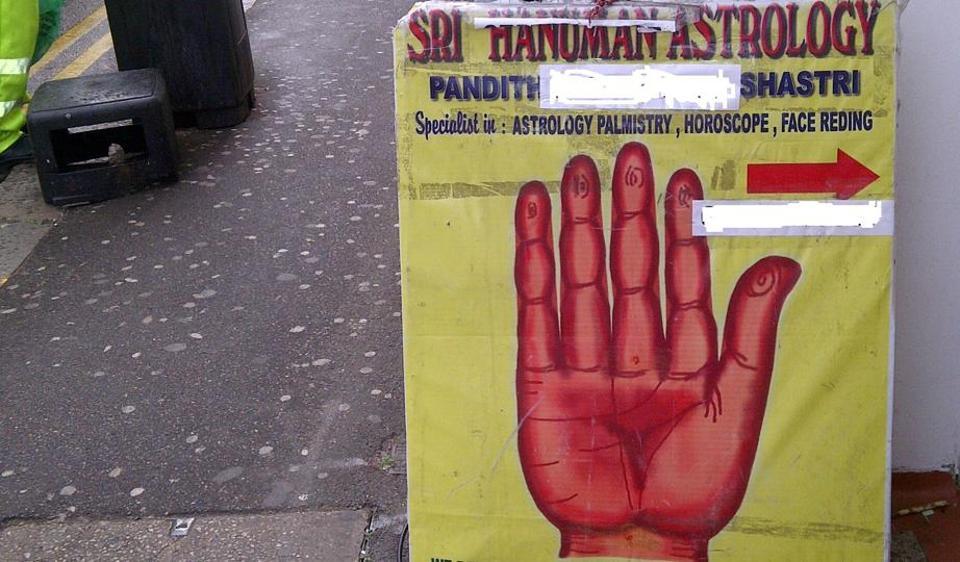 Roadside poster for an astrologer in Hounslow, London.