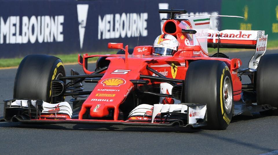 Ferrari's German driver Sebastian Vettel speeds down the main straight on the way to winning the Formula One Australian Grand Prix in Melbourne on Sunday.