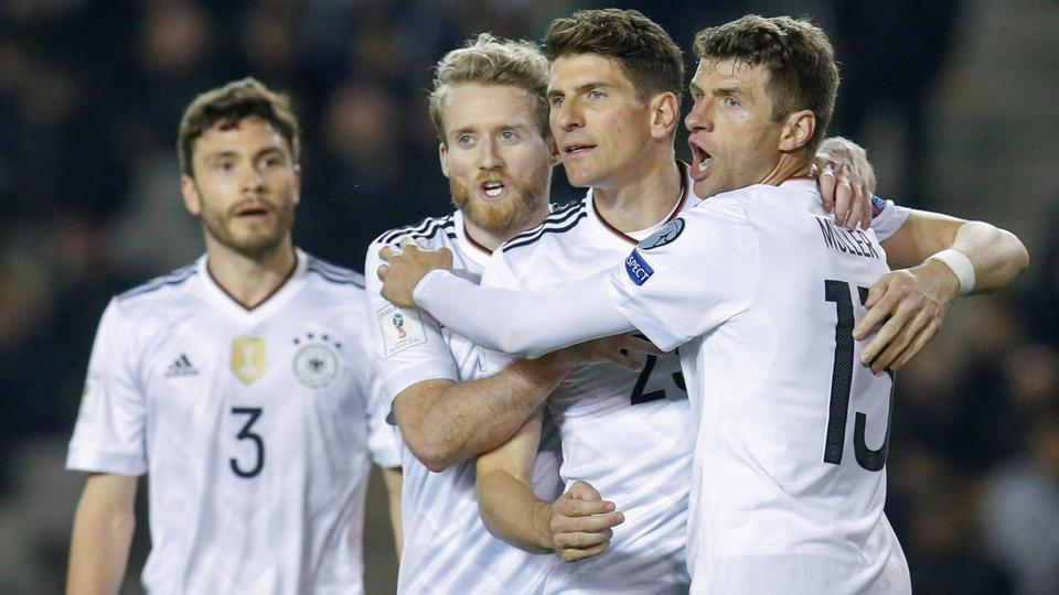 Andre Schuerrle celebrates after scoring his second goal against Azerbaijan in World Cup qualifiers.