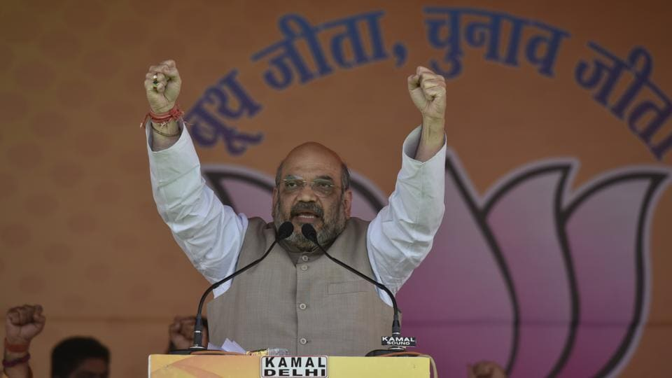 BJP president Amit Shah speaks ahead of the MCD elections at Ramlila Ground in New Delhi on Saturday.