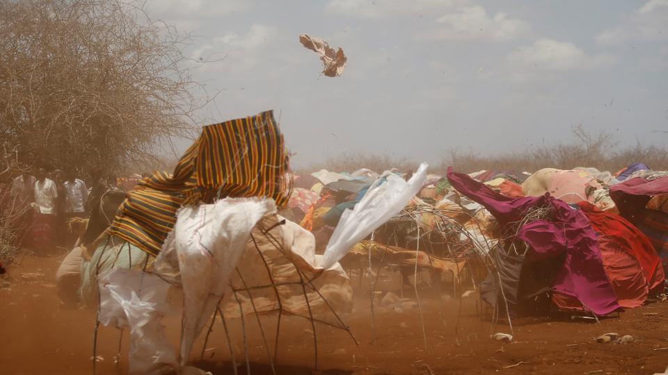 A dust storm sweeps through a makeshift camps in Baidoa, west of Somalia's capital Mogadishu. Thousands of desperate Somalis have streamed into Baidoa in south-western Somalia seeking food and medical care as a result the country's prolonged drought. The influx has overwhelmed local and international aid agencies. (Feisal Omar/REUTERS)