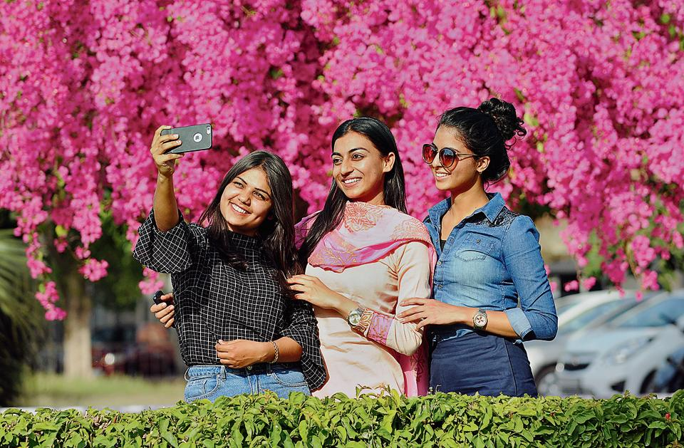 Girls taking a selfie at Panjab University in Chandigarh on Monday.