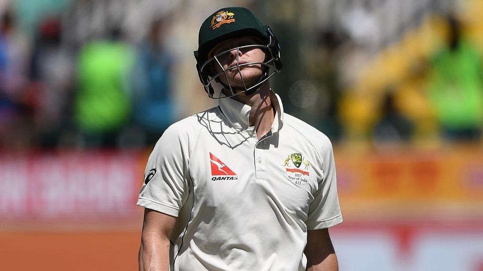 Australia's captain Steve Smith reacts as he walks back to the pavilion after his dismissal by India's Bhuvneshwar Kumar during the third day of the fourth and last Test cricket match between India and Australia in Dharamsala.