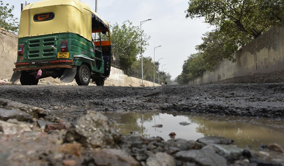 A potholed road Dallupura in east Delhi.