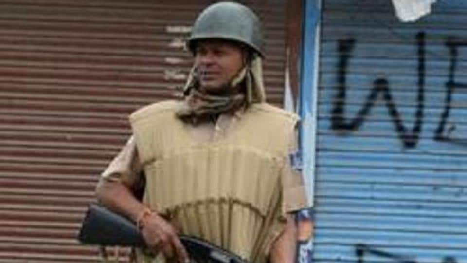 A security force personnel holds a pellet gun as he patrols in Srinagar. The Supreme Court asked the Centre to consider effective means other than use of pellet guns to quell stone pelting mobs in Jammu and Kashmir.