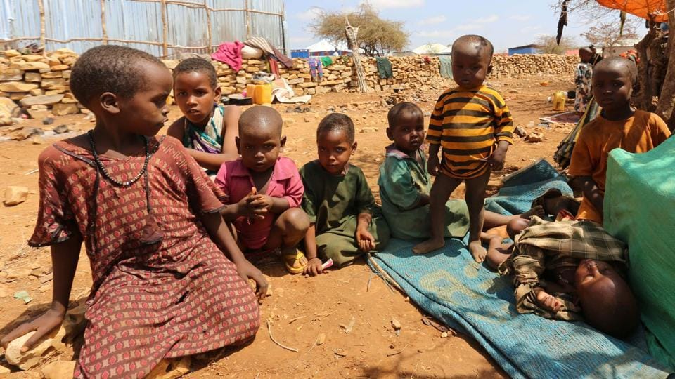Internally displaced Somali children rest outside their shelter. In recent weeks, aid agencies have started a cholera vaccination campaign across Somalia. (Feisal Omar/REUTERS)