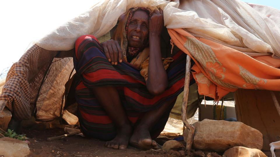An internally displaced Somali woman rests outside her shelter. Somalia's drought is threatening 3 million lives, according to the U.N. In recent months, aid agencies have been scaling up their efforts but they say said more support is urgently needed to prevent the crisis from worsening. (Feisal Omar/REUTERS)