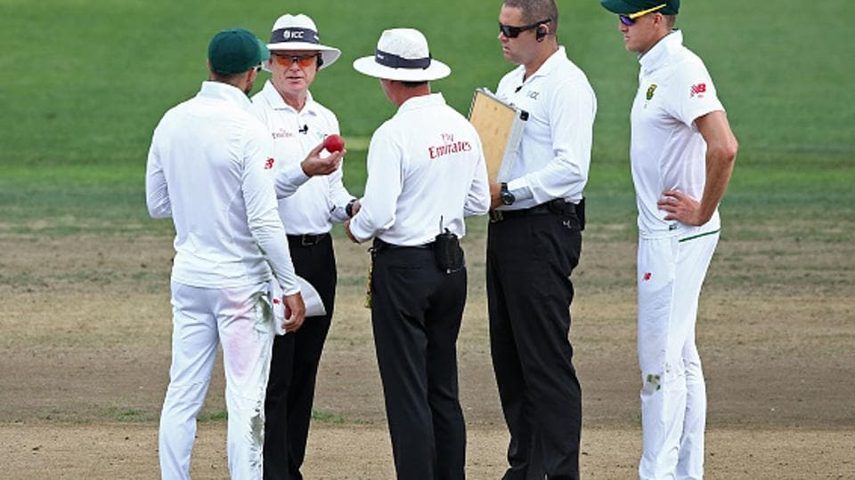 Umpires Bruce Oxenford (L) and Rod Tucker discuss the state of the ball with South Africa cricket team captain Faf du Plessis during day three of the third Test vs New Zealand Cricket team in Hamilton on Monday.