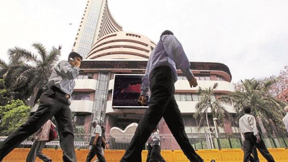 nvestors walking past BSE building.
