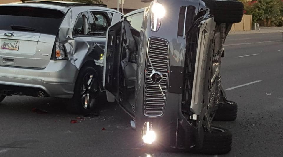 A self-driven Volvo SUV owned and operated by Uber Technologies Inc. is flipped on its side after a collision in Tempe, Arizona, U.S.