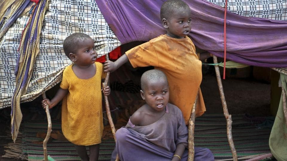 Newly displaced Somali children stand outside their makeshift shelter at a camp in Baidoa, Somalia. Many of them are clueless about what to do next. (Farah Abdi Warsameh/AP)