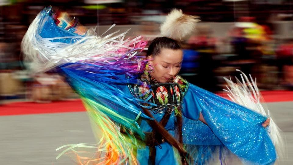 A Native American woman dancer competes during the 43rd Annual Denver March Powwow held at the Denver Coliseum on March 25, 2017 in Denver, Colorado. (Jason Connolly / AFP)