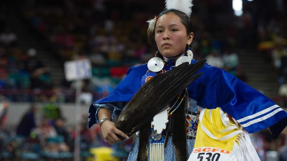 A Native American woman dancer competes during the 43rd Annual Denver March Powwow held at the Denver Coliseum. (Jason Connolly / AFP)