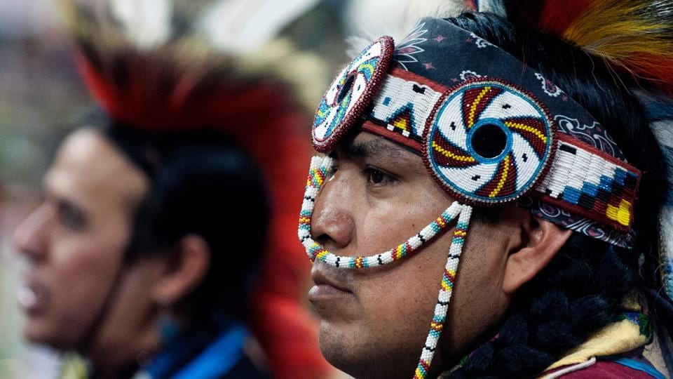 A Native American dancer participates during the Grand Entry of the 43rd Annual Denver March Powwow held at the Denver Coliseum (Jason Connolly / AFP)