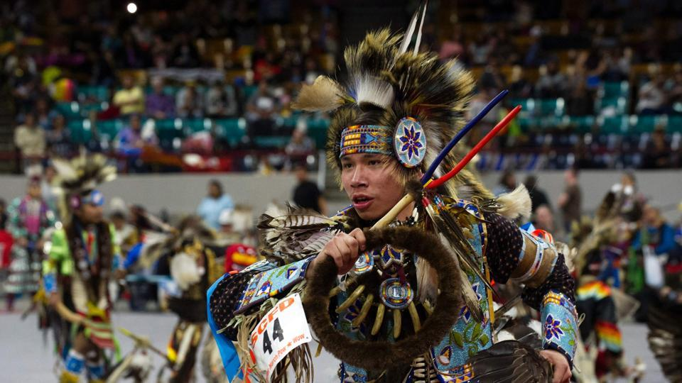 Held over four days, the Denver March Powwow attracts an estimated 55,000 participants, made up of dancers, drummers, vendors, and spectators.  (Jason Connolly / AFP)