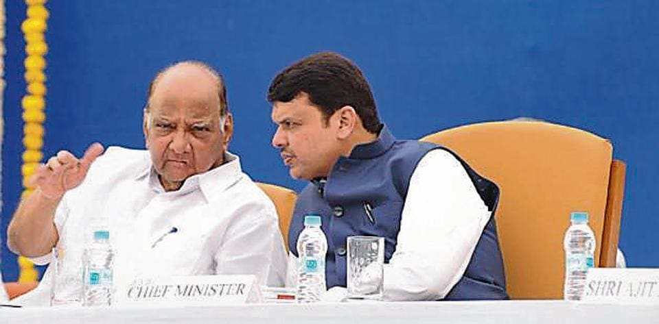 Maharashtra CM Devendra Fadnavis (right) with NCP chief Sharad Pawar during the VSI's general body meeting at Pune on Monday.
