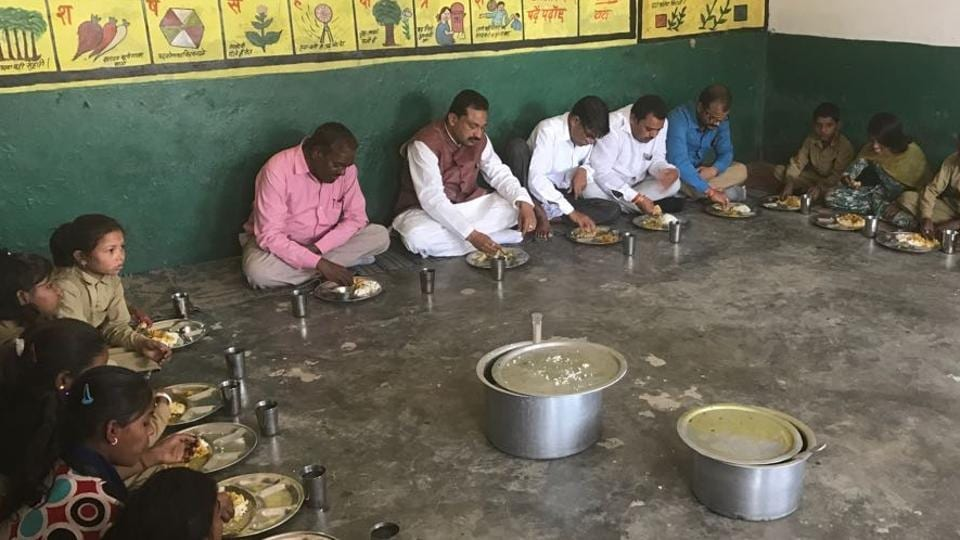 BJPMLASanjay Gupta sharing mid-day meal with students of a government school in Chail constituency.