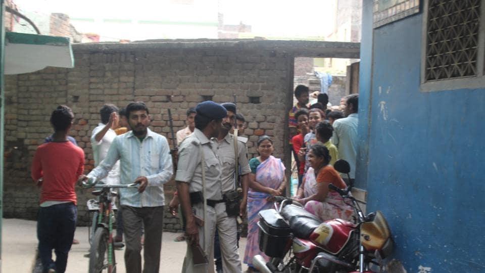 Police outside the residence of school teacher at Mirwasi Tola (Phulwarisharif) in the state capital.