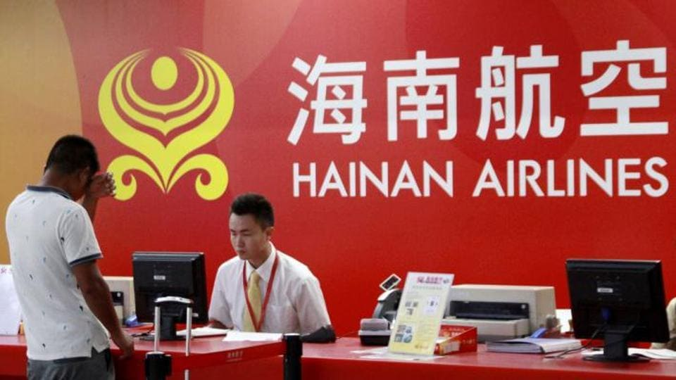 A customer stands in front of a counter of Hainan Airlines at an airport in Haikou, Hainan province, China.