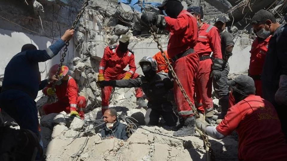 Iraqi firefighters look for bodies buried under the rubble, of civilians who were killed after an air strike against Islamic State triggered a massive explosion in Mosul, Iraq March 27, 2017.