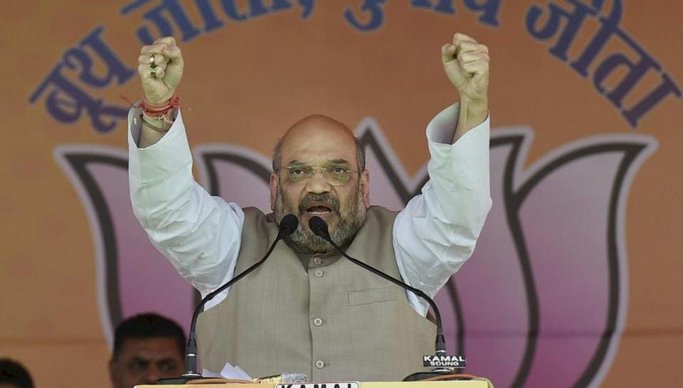 BJP president Amit Shah gestures during the Panch Parmeshwar Sammelan ahead of the MCD election at Ramlila Grounds in New Delhi on Saturday.