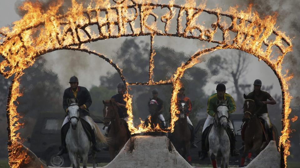 Nepalese army soldiers demonstrate their horse riding skills during the Ghode Jatra festival.  (AP/PTI)