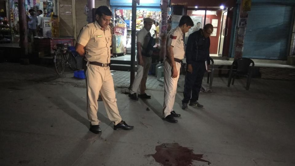 Police inspect the scene of crime outside the Patanjali store in Sector 21 on Monday night.