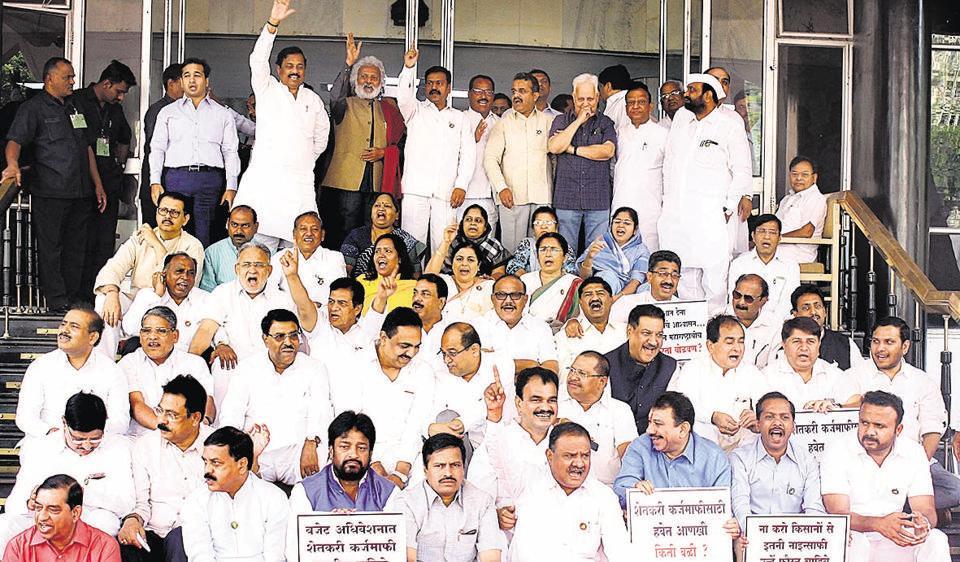 Members from Opposition protest outside Vidhan Bhavan demanding farm loan waiver.