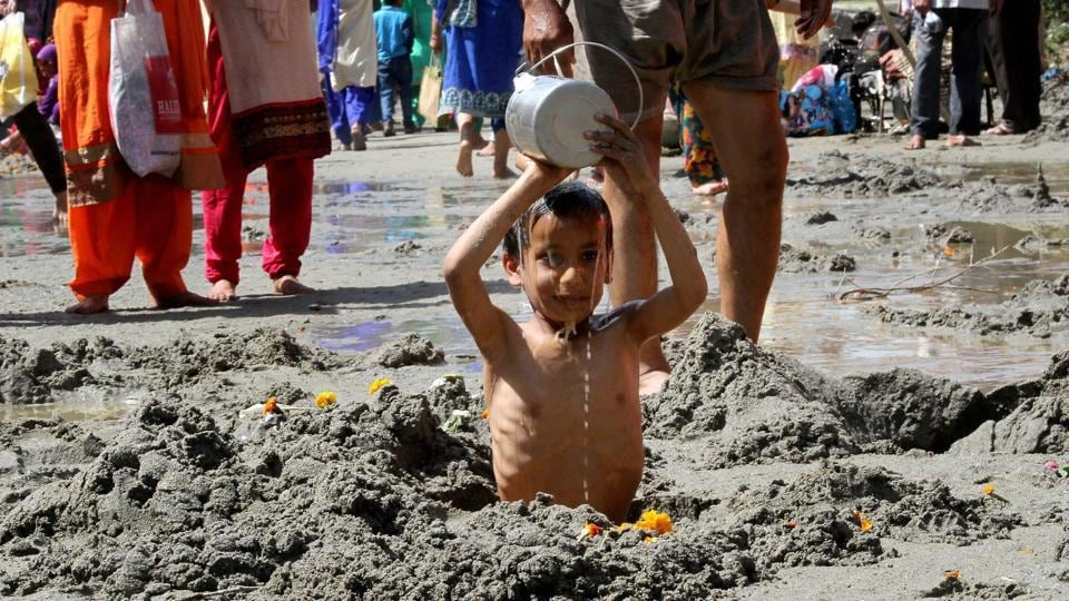 A child devotee offering prayer during the three-day Chadhi Yatra ahead of Navratra festival, at Parmandal, about 25 km from Jammu. (PTI)