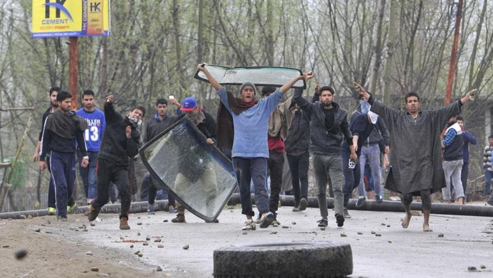 Three men were killed and several others injured on Tuesday when security forces battling militants fired on stone-pelting protesters in Chadoora area of central Kashmir's Budgam district, police said. (Waseem Andrabi / HT Photo)