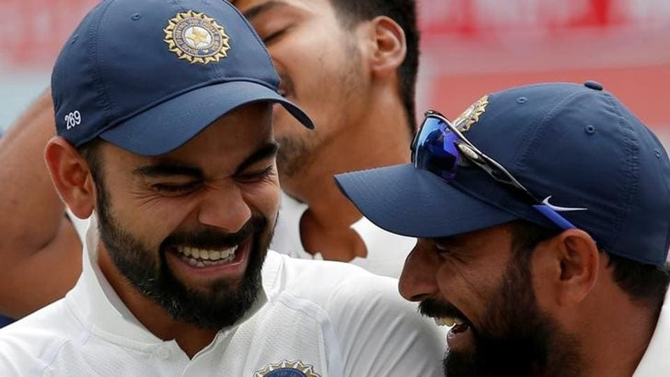 India's Virat Kohli and Mohammed Shami (R) shares a moment during the award ceremony after winning the series against Australia. (REUTERS)