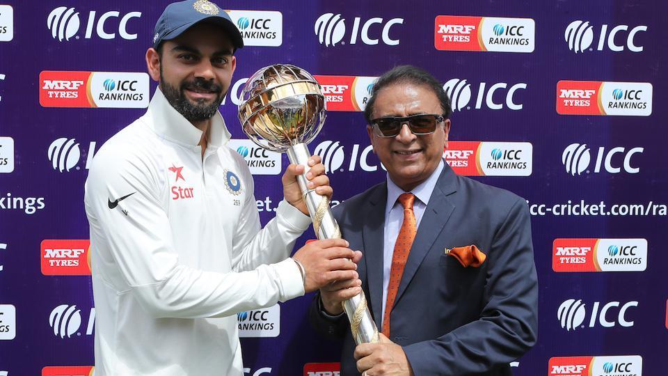 Indian cricket team captain Virat Kohli receives the ICC Test Championship mace from Sunil Gavaskar.