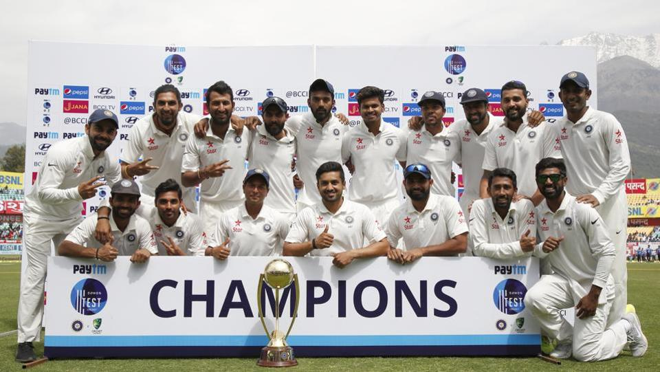 Indian cricket team players with the Border–Gavaskar Trophy after defeating Australia by eight wickets in the Dharamsala Test.