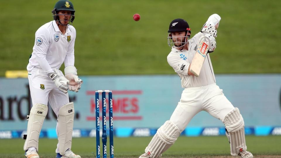 Kane Williamson plays a shot as Quinton de Kock of looks on Day 4 of the third Test between New Zealand and South Africa at Seddon Park in Hamilton on Tuesday.