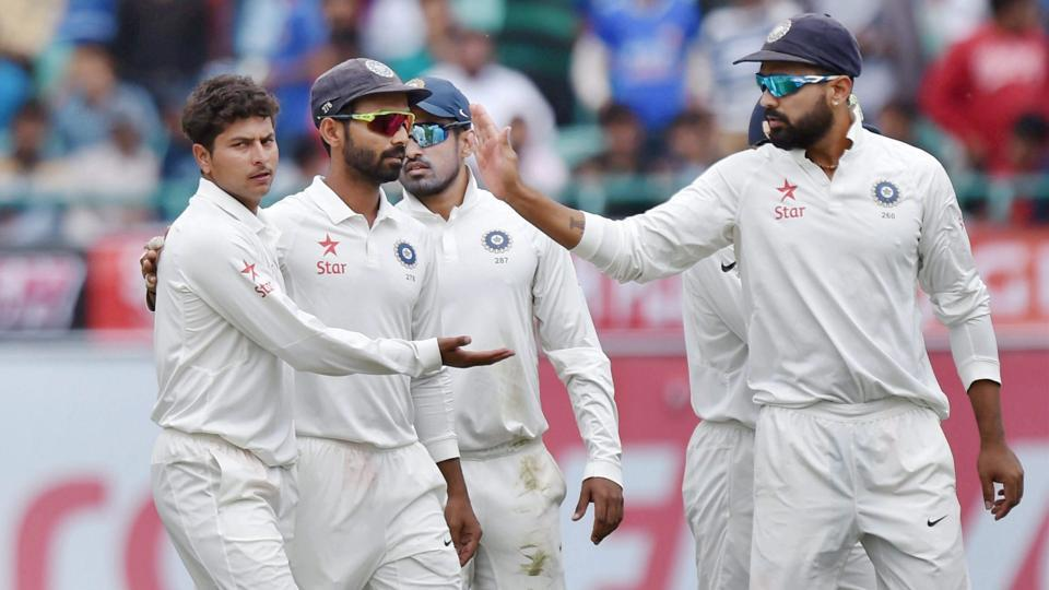 Kuldeep Yadav (left) picked four wickets in the first innings of the India vs Australia Dharamsala Test that India won by eight wickets.