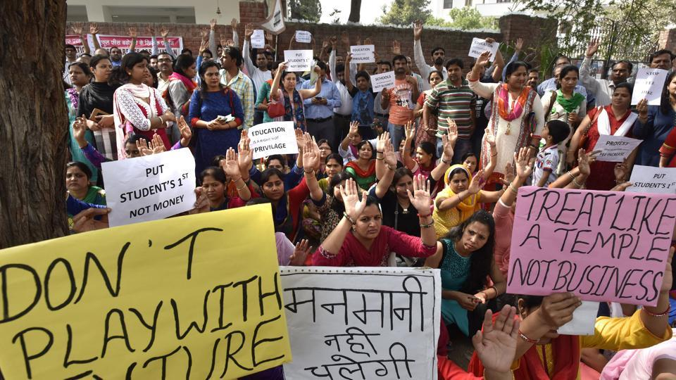 Parents hold a protest against the fee hike by DPSG in Palam Vihar, on Friday.
