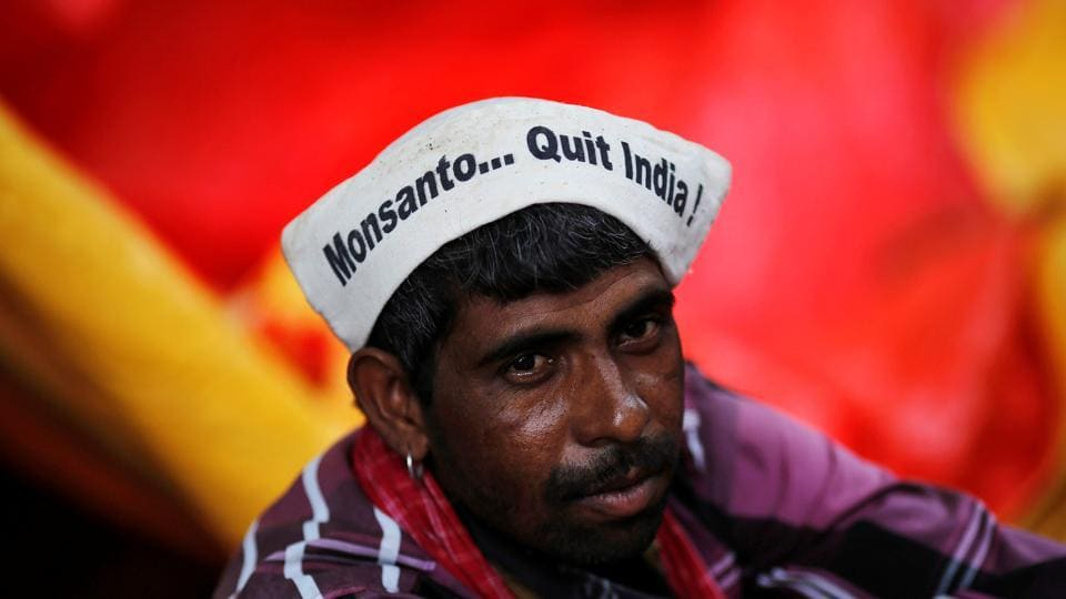 A farmer attends a day-long protest in New Delhi August 8, 2013.