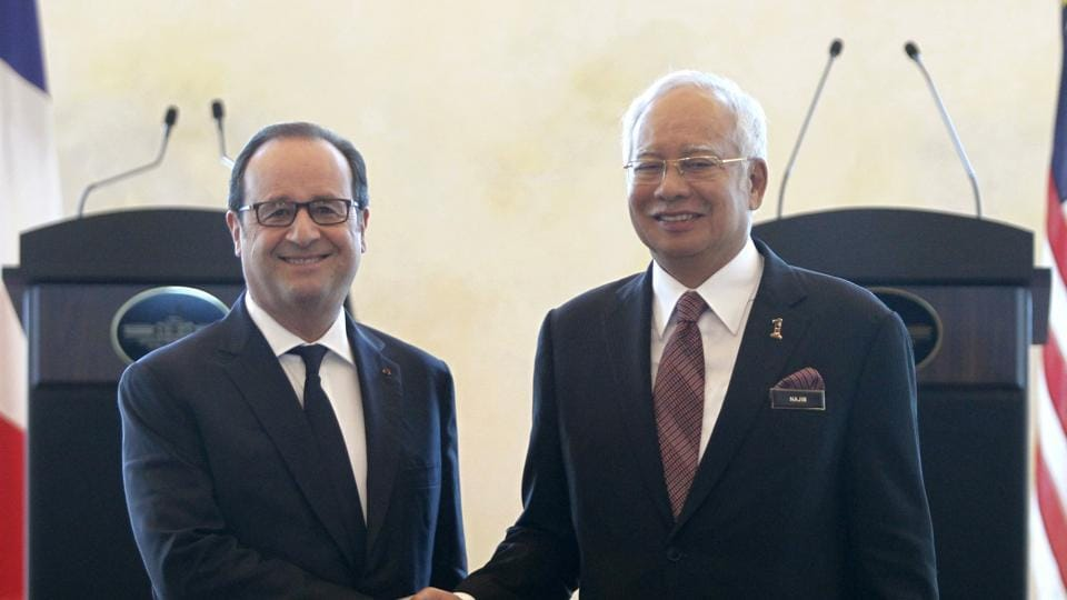 French President Francois Hollande (left) and Malaysian Prime Minister Najib Razak shake hands after a press conference at Seri Perdana Building in Putrajaya in Malaysia on Tuesday.